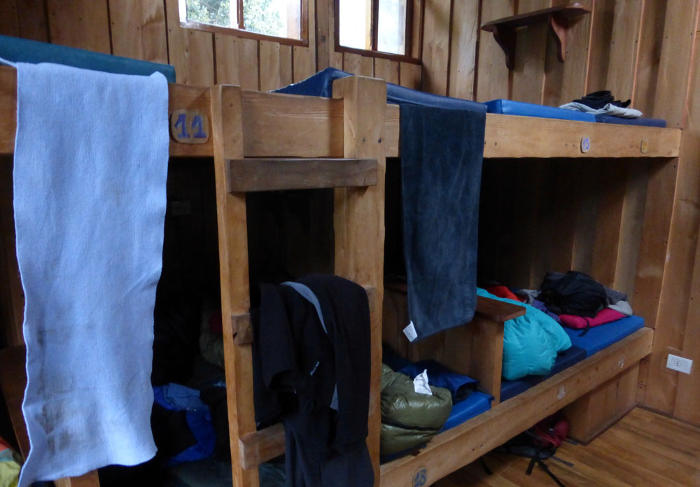 Bunkhouse with numbered beds in Chile