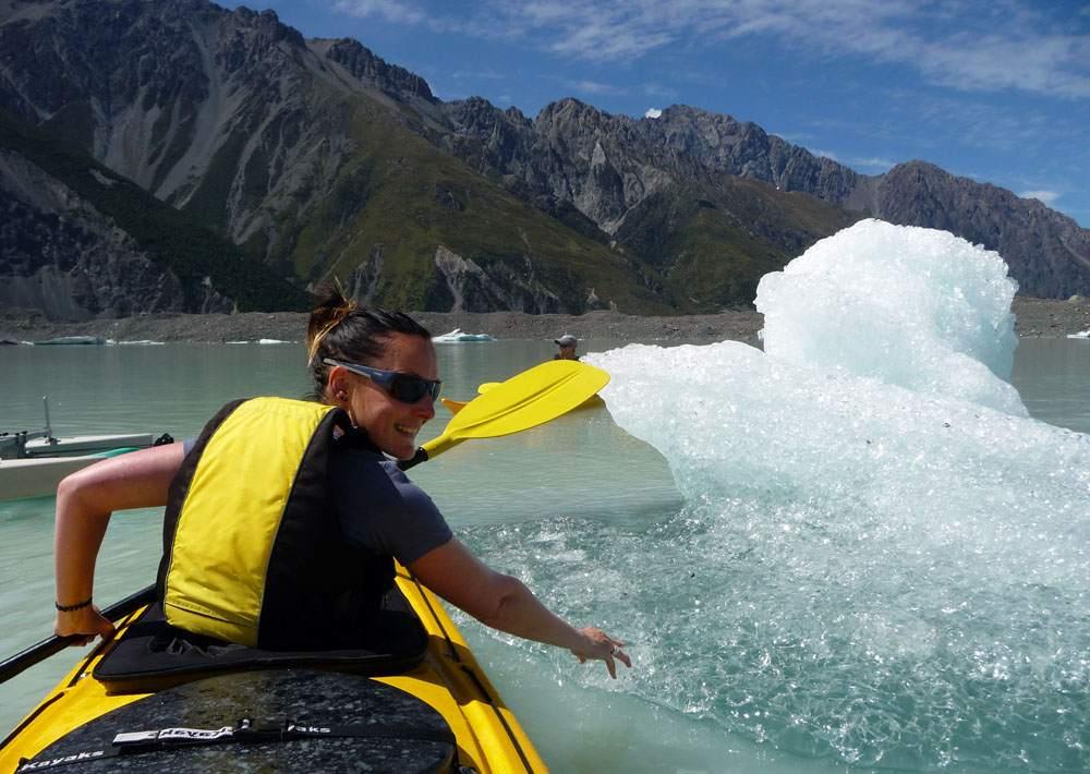 kayaking between icebergs in mount cook national park