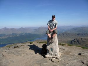 Martijn sitting on top of Ben Lomond.